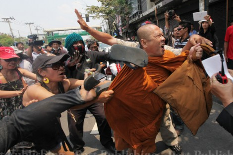 Red Shirts assaulting Monk