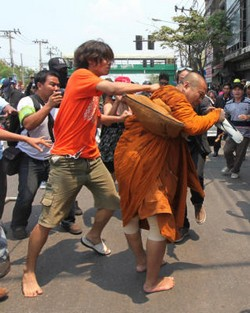 Red Shirts attacking Monk